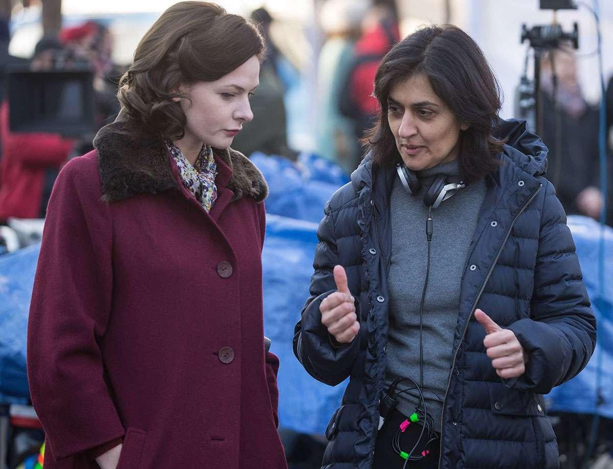 Shamim Sarif directing Rebecca Ferguson on the set of Despite the Falling Snow